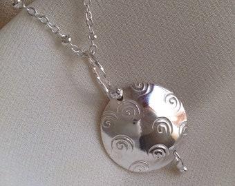 Sterling swirl desing stamped disk  necklace