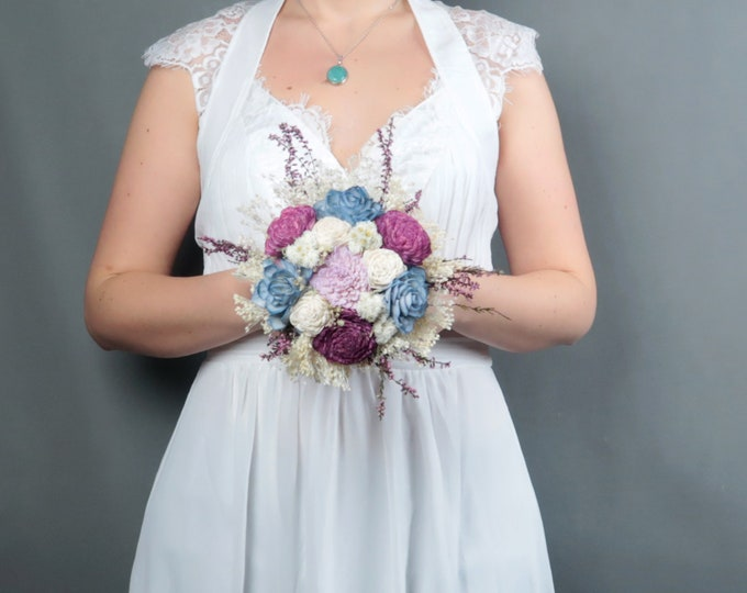 Pastel wedding small bridesmaid bouquet blue lavender purple ivory sola and preserved flowers real heather spring romantic wedding