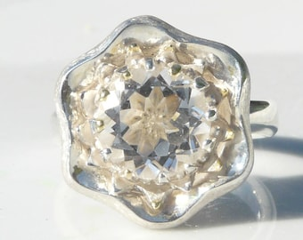 Ice Flower Ring.Unique and dazzling Statement Ring in Silver with some 18 kt Yellow Gold detail and set with a brilliant Rock Crystal stone
