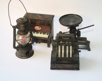 Vintage miniature die cast iron pencil sharpener- PLAYME.  Made in 1970's. 4 collectable pieces:  piano, cash register, lamp and balance.