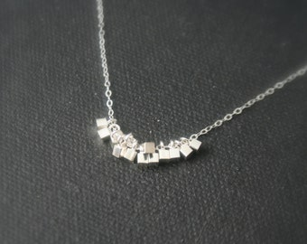Simple, tiny, sterling silver necklace with tiny squares, cubes