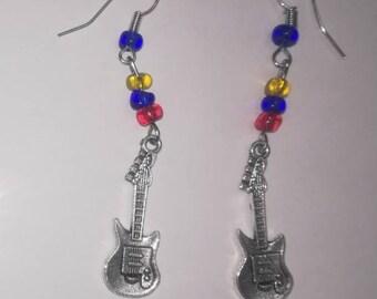 Earrings dangling guitar and pearls