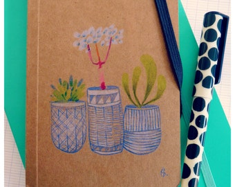 Small moleskine Kraft, decorated by hand.