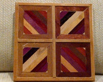 Wood wall art sculpture featuring a variety of exotic wood pieces in a geometric array.