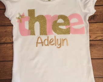Pink and gold birthday shirt with gold name embroidery