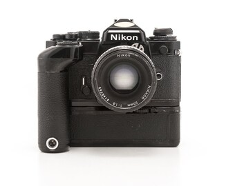 Nikon FE2 35mm Film Camera with NIKON Nikkor 50mm 1.8 lens and Nikon MD-12 Motor Drive - Working - A Great Student Camera