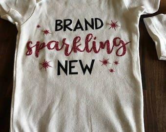 Brand Sparkling New baby onesie