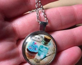 "Silver Accented Alice In Wonderland Blue Cupcake ""Eat Me"" Dangle Necklace, Food Necklace"