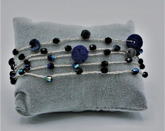 Long necklace and/or hand-made bracelet with crystals and boule.