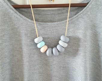 Chunky unique polymer clay necklace. Light grey, light blue, light peach. Beaded necklace