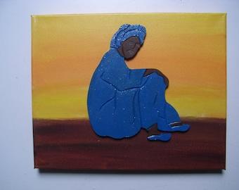 Tuareg picture(board) sat(based) in the desert