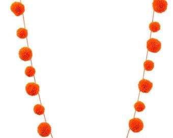 Neon orange pompom garland