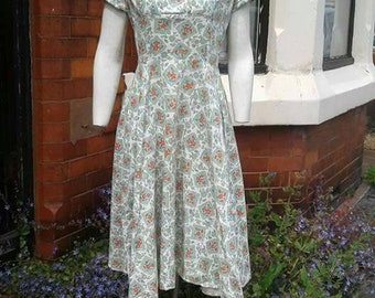Beautiful 1940s volup cotton Summer printed light green, orange, blue and brown holiday wedding