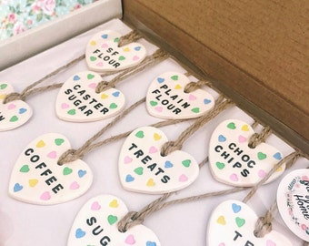 Pastel heart shaped clay storage tags, candy cane, pantry, labelling, jar labels, organisation, kitchen, blue, pink. Green, yellow