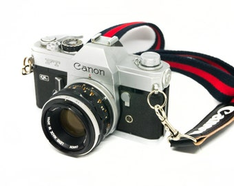 Canon FT 35mm film SLR camera with 50mm F1.8 Canon lens with genuine strap