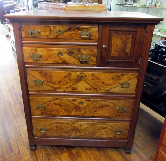 Antique tall dresser with burl wood