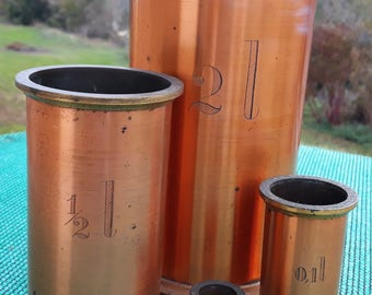 Vintage set of 4 brass and copper measuring jugs