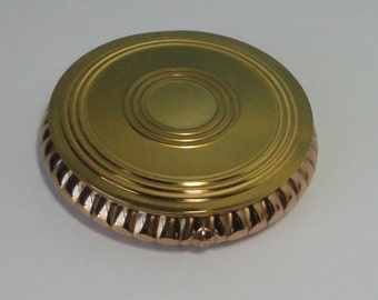 Gold tone metal  Majestic Compact. Never used.