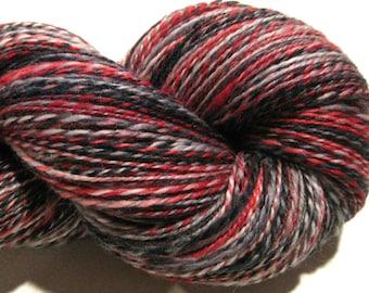 Handspun yarn, Notorious 610 yards, DK weight, black yarn, red yarn, 2 ply,  Superwash BFL wool, Nylon, sock yarn, knitting supplies