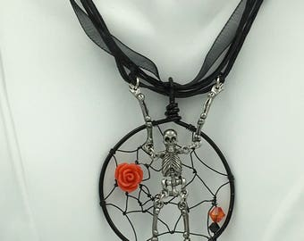 Black Widow Spider Web Coco Necklace Pendant w/Skeleton caught in a Web adorned w/Festive Rose and the finest Swarovski Crystals. Steampunk.