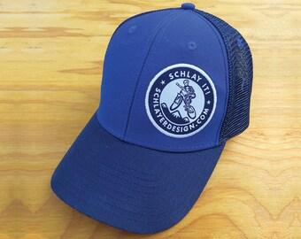 """Schlayer Design """"Schlay it!"""" Trucker Hat. Blue on blue."""