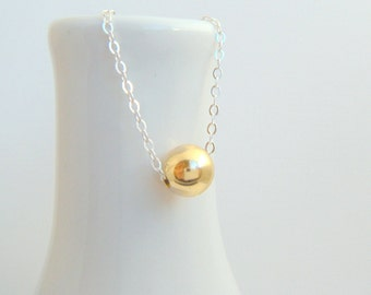gold with silver necklace. 14k 14 k yellow gold filled bead. mixed metals. round and small dainty. sterling chain. delicate jewelry 8 mm