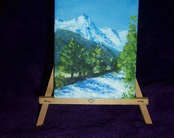 A mini oil painting on a canvas block of the Alps with the river from a glacier in the foreground 9 cm x 7 cm