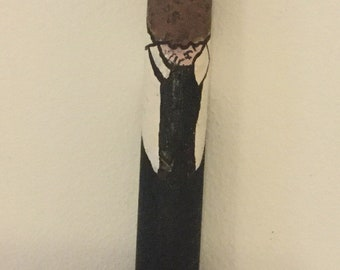 Driftwood, painted  policeman hanging decoration.
