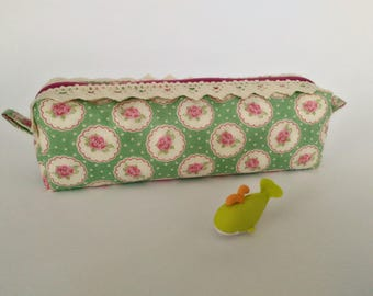 Square green and pink floral print fabric clutch.