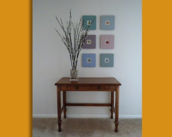 Three signed, original watercolors, with hand-crafted frames.  Amoeba (Gray Frame), Mini Skirt (yellow frame), and Linked (soft aqua frame)