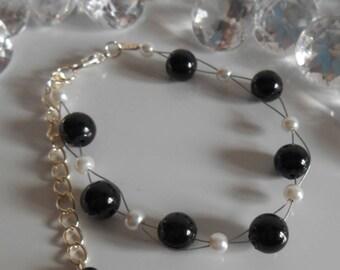 Wedding bracelet twist of black and white beads