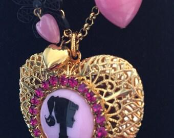 Tarina Tarantino Barbie Heart Locket necklace.