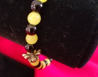 Black and yellow beaded bracelet with bumble bee charm