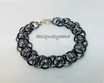 Silver and black helm weave chain maille bracelet