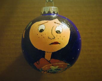 Coraline holding a snow globe