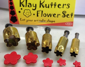 "Plunge style Flower cutter by Kemper Klay Kutters  set of 5 flower sizes 3/8"" to 3/4"""