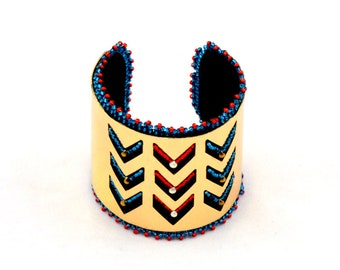 Embroidered cuff metal