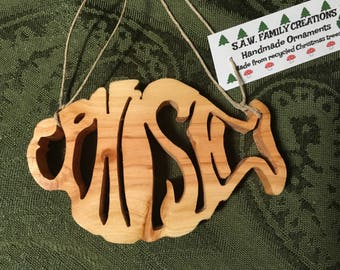 Handmade wooden ornament made from a recycled Christmas tree Phish
