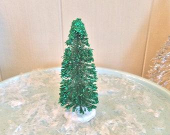 4 inch tall emerald green Bottle brush tree