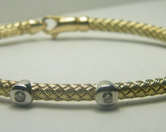 14kt yellow gold flexible 5 diamond bracelet