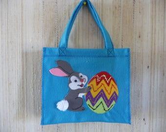 Child's purse in blue felt Bunny pattern.