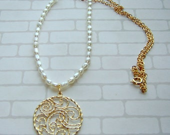 Gold filigree pendant and freshwater pearls.
