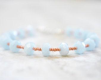 aquamarine and rose gold seed beaded bracelet. faceted aquamarine rondelles with rose gold seed beads. icy blue and rose gold bracelet