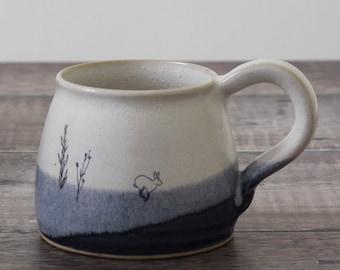 Ceramic mug with hares rabbits, blue and white mug, handmade mug, ceramic tea coffee mug, illustrated pottery, stoneware