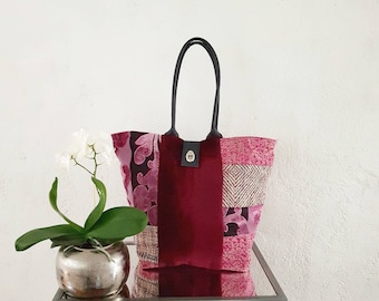 Blend of designer fabrics and leather tote bag