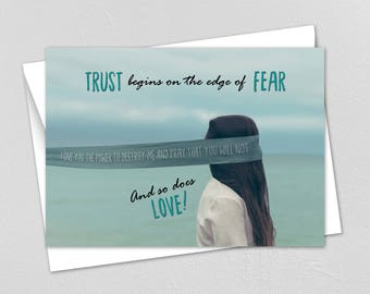 BDSM Card. Trust begins on the edge of fear and love. Blindfolded woman on a cliff. S and M Card. Fetish card. Master and slave.