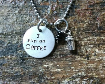 I run on COFFEE hand stamped pendant. Your choice of either Necklace or Keychain