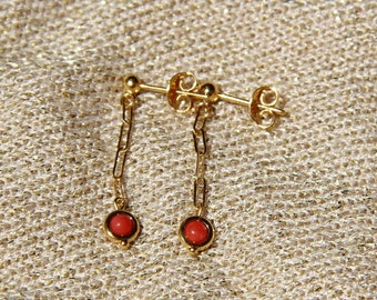 Red coral earrings match the necklace