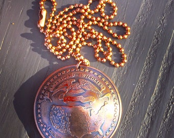 American Wildlife Domed coin pendant with chain.