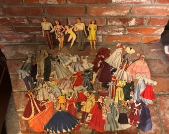 Lot of Paper Dolls and Paper Clothes